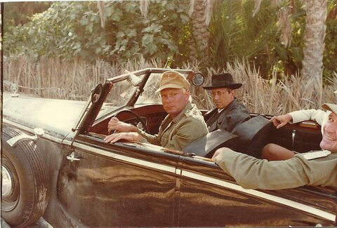 On the set of the 1981 film, Raiders of the Lost Ark. Rocky Taylor in the driving position next to his friend and fellow stuntman, Romo Gorrara.