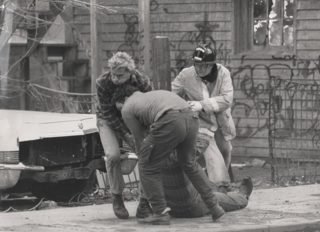 Rocky Taylor being carried away from the heat of the burning building after his fall on Death Wish 3 by stuntmen Jazzer Jeyes and Tom Delmar.