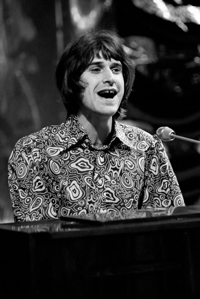 The Kink's Ray Davies sits at a piano on Top of the Pops in 1969