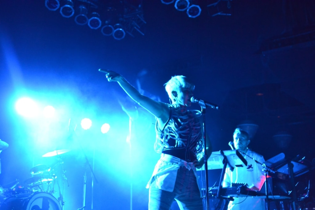 Robyn bathed in blue light, performing on stage at the House of Blues in Cleveland, OH