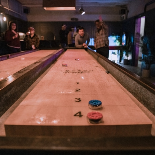 A man plays shuffleboard