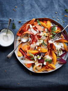 a colourful carrot salad with a cinnamon yoghurt dressing