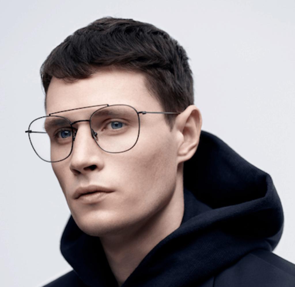 Model wearing Komono glasses