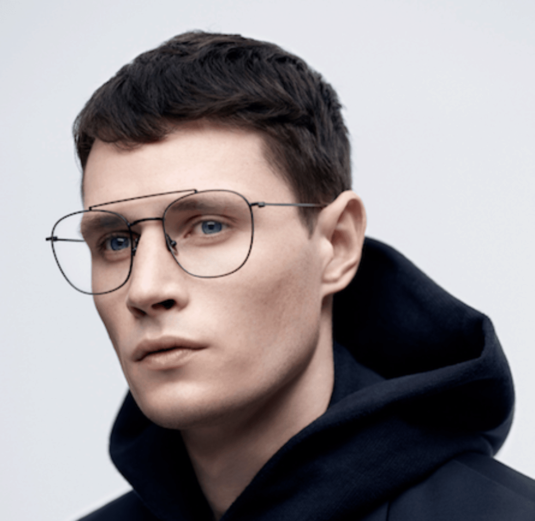 Model wearing Komono glasses