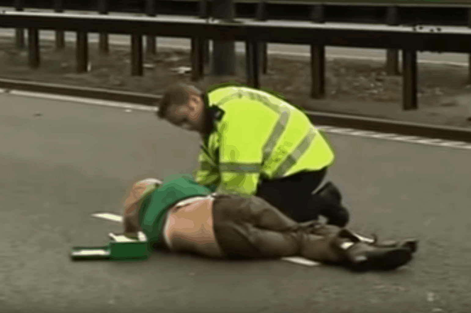 Ursula Eriksson being tended to by a policeman