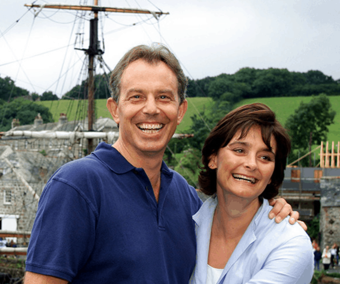 Tony and Cherie Blair grinning like Cheshire cats