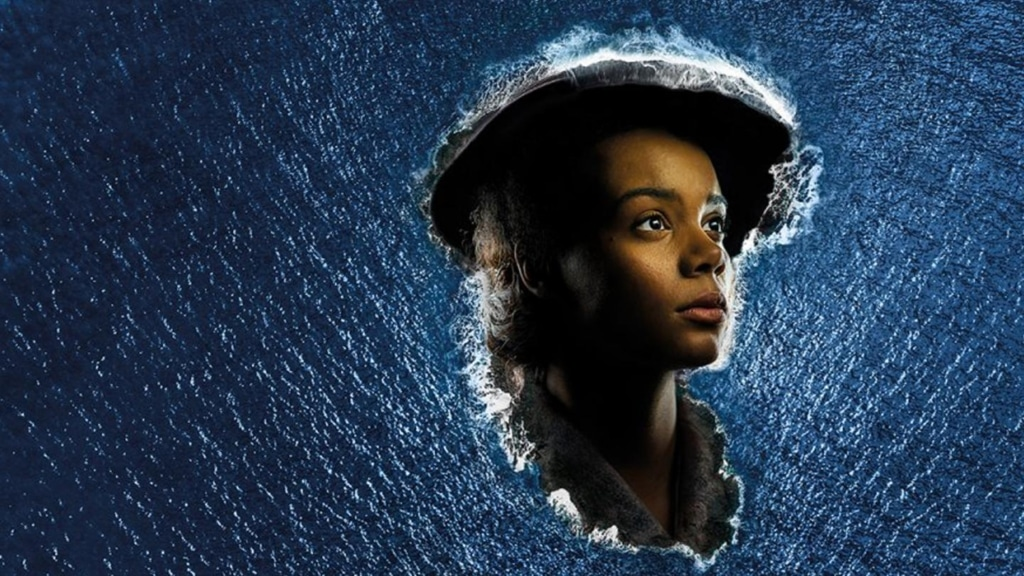 Image of a black woman's head in the middle of an ocean from Small Island play at The National Theatre