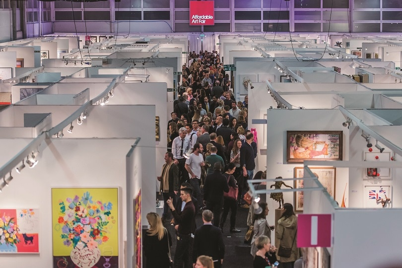 Crowds of people browsing the art collections at the affordable art fair