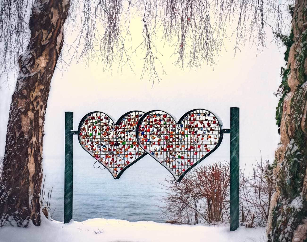 A sign featuring two interlocking hearts on a mountain top to celebrate Valentine's