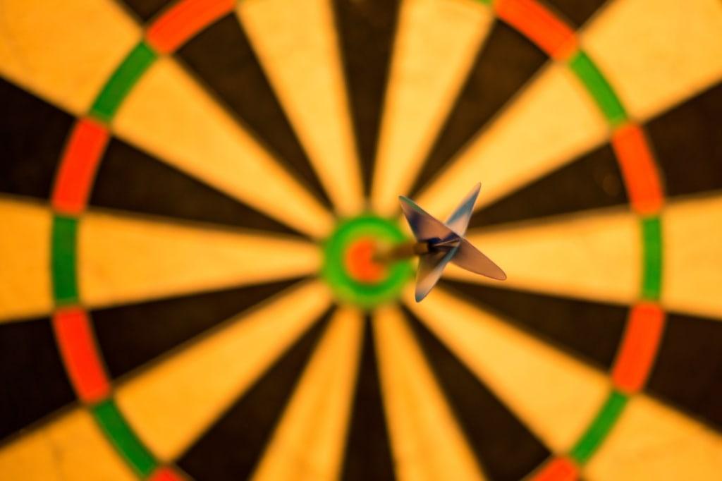 A dart resting in the bullseye