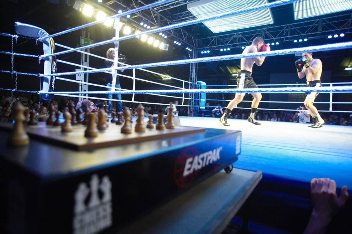 Two men in ring boxing