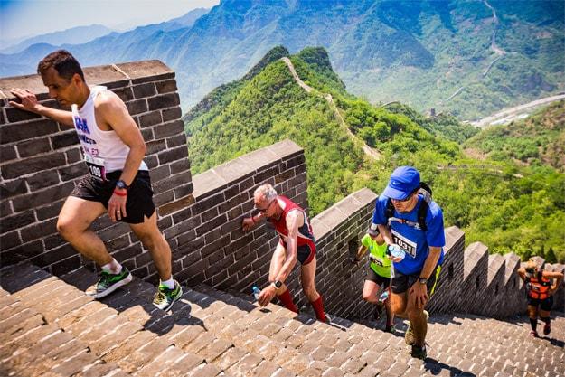 Runners climb steep steps in the Great Wall marathon