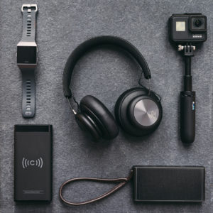 Selection of tech gear, including headphones, fitbit, GoPro Black7 photographed for The MALESTROM's Christmas Tech gift guide