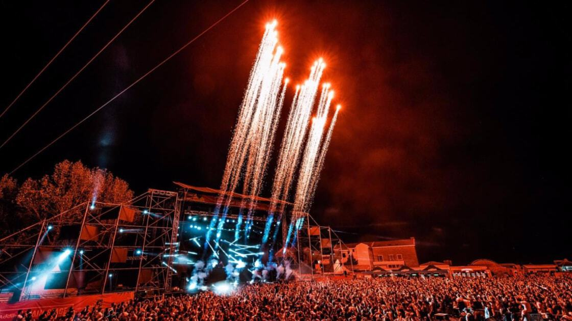 Fireworks blast skywards from an outdoor music stage