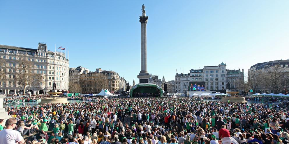 Crowds of people gather at Trafalgar square on St Patrick's Day