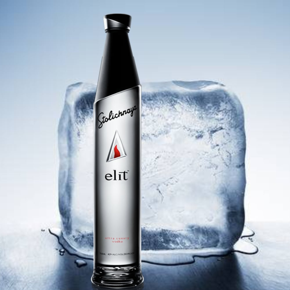 Bottle of stolichnaya elit in front of a large block of ice
