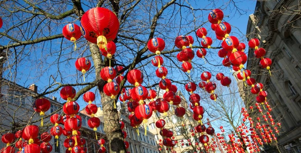 Red lanterns hanging from a tree